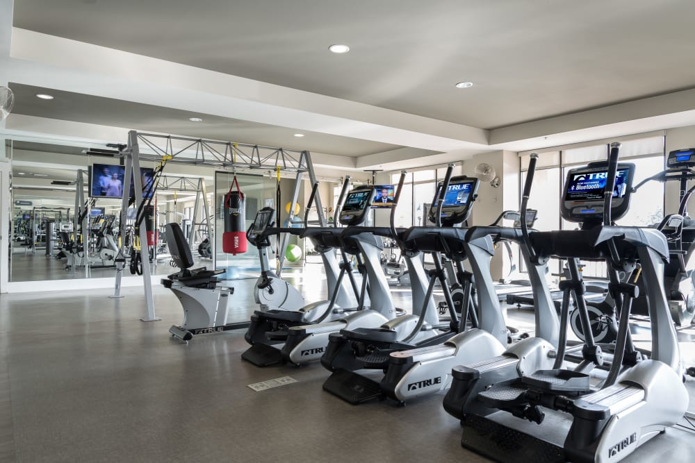Well equipped fitness center at Carraway Village Apartments