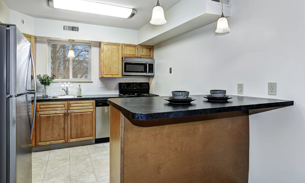 Kitchen with breakfast bar to serve and eat on at Penn Crest Apartments in Allentown, Pennsylvania