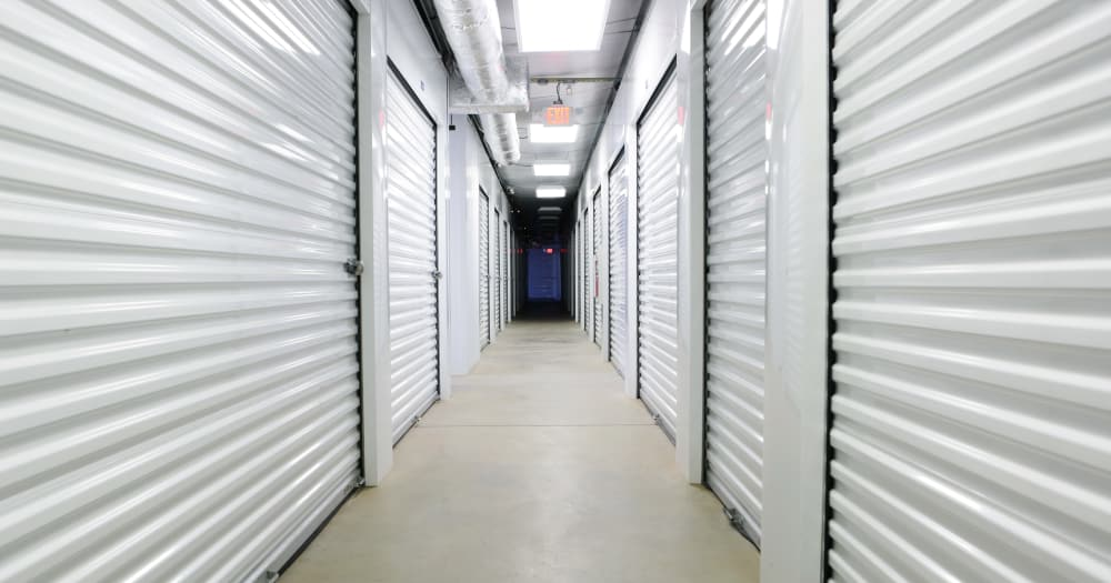 Storage units with white doors at Midgard Self Storage in Woodstock, Georgia