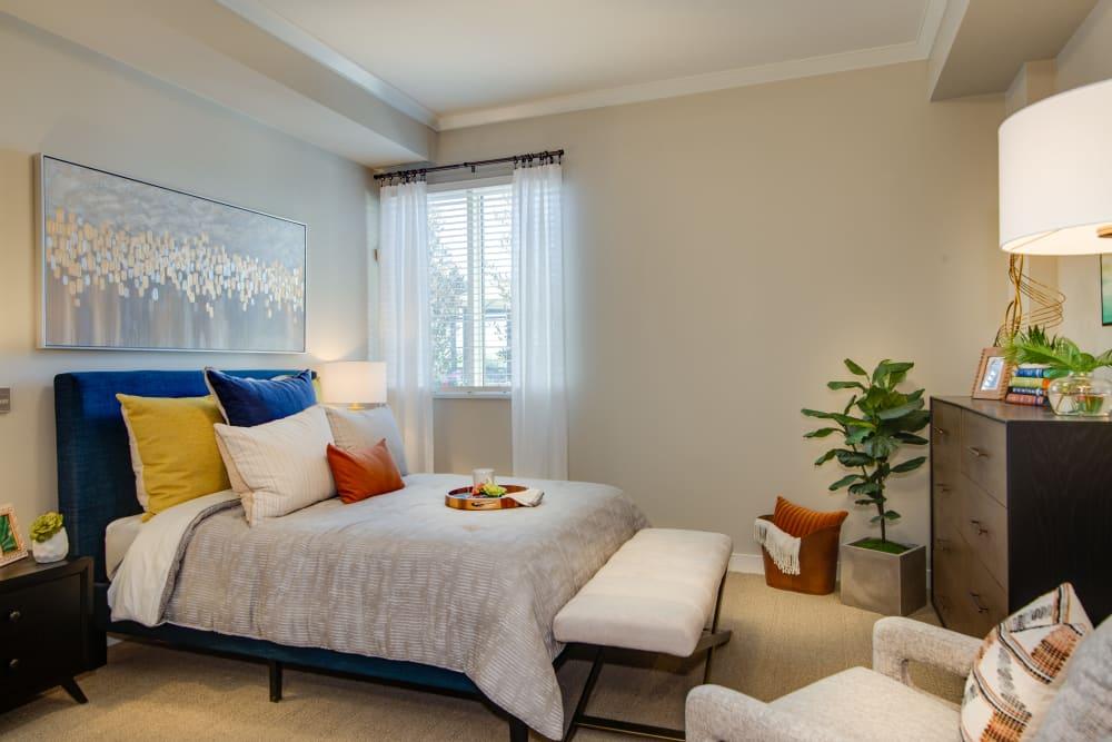 Modern brightly lit bedroom in senior living apartment at Sage Glendale in Glendale, California