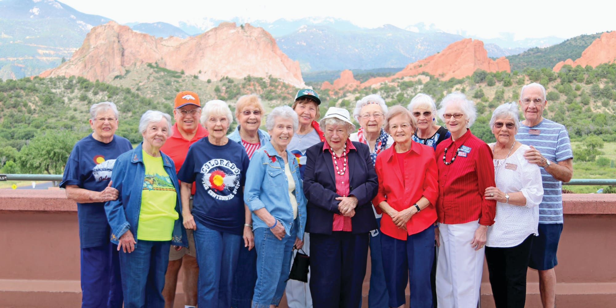 Residents from Summit Glen in Colorado Springs, Colorado in front of a beautiful landscape