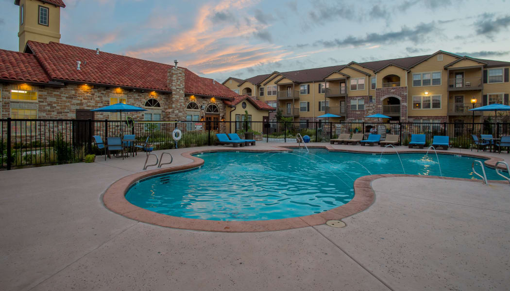 Pool with water features at Portofino Apartments in Wichita, Kansas