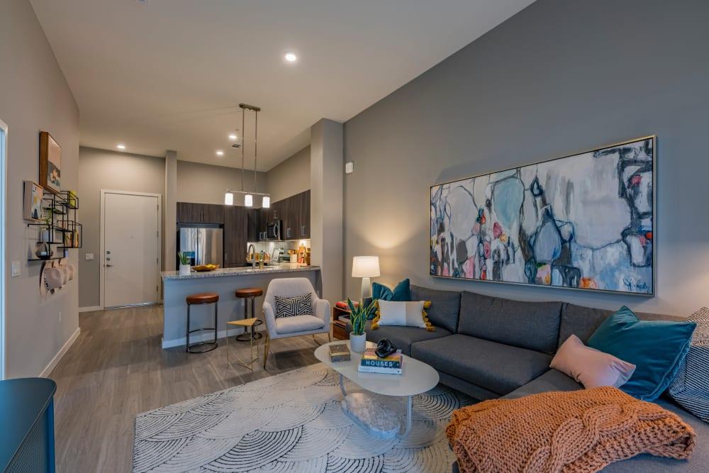 Living room with wood style flooring at Encore Tessera in Phoenix, Arizona