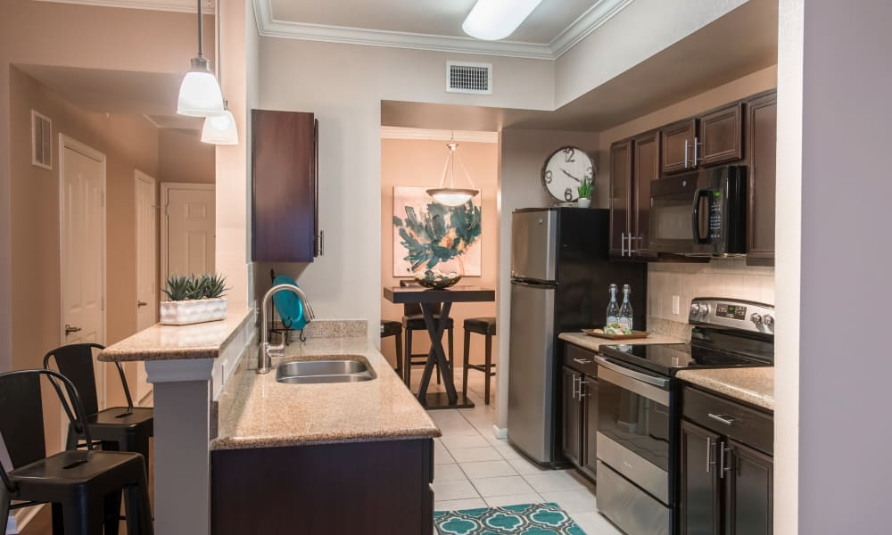 Modern design and fixtures in a kitchen at Estancia at Ridgeview Ranch in Plano, Texas