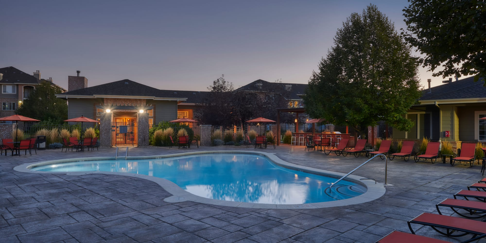 Sunrise pool view with lounge chairs and clubhouse in Thornton, CO