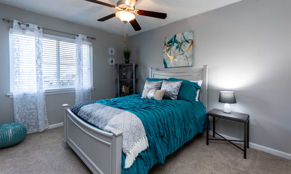 Bedroom with blue accents at Lexington Park Apartments in Smyrna, Georgia