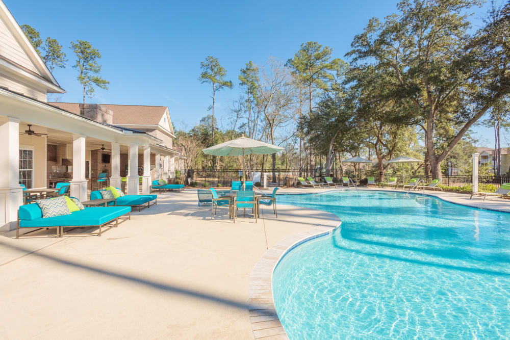 Plenty of lounge chairs surrounding outdoor pool at Arbor Village in Summerville, South Carolina