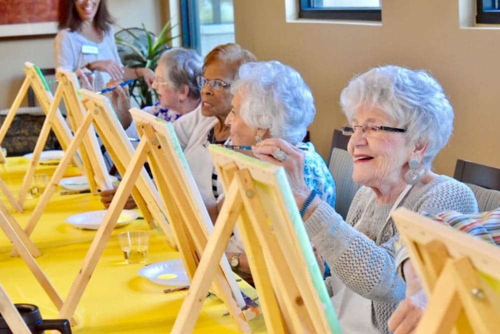 Residents painting at Village Place Senior Living in Port Charlotte, Florida