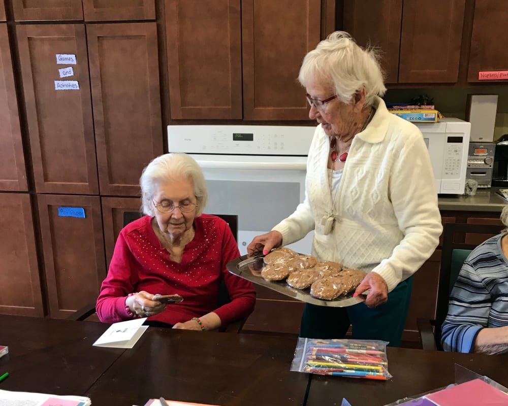 Resident sharing baking goods at Edencrest at Riverwoods in Des Moines, Iowa.