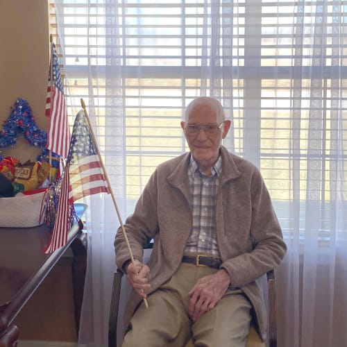 Resident with an American flag at Canoe Brook Assisted Living in Duncan, Oklahoma