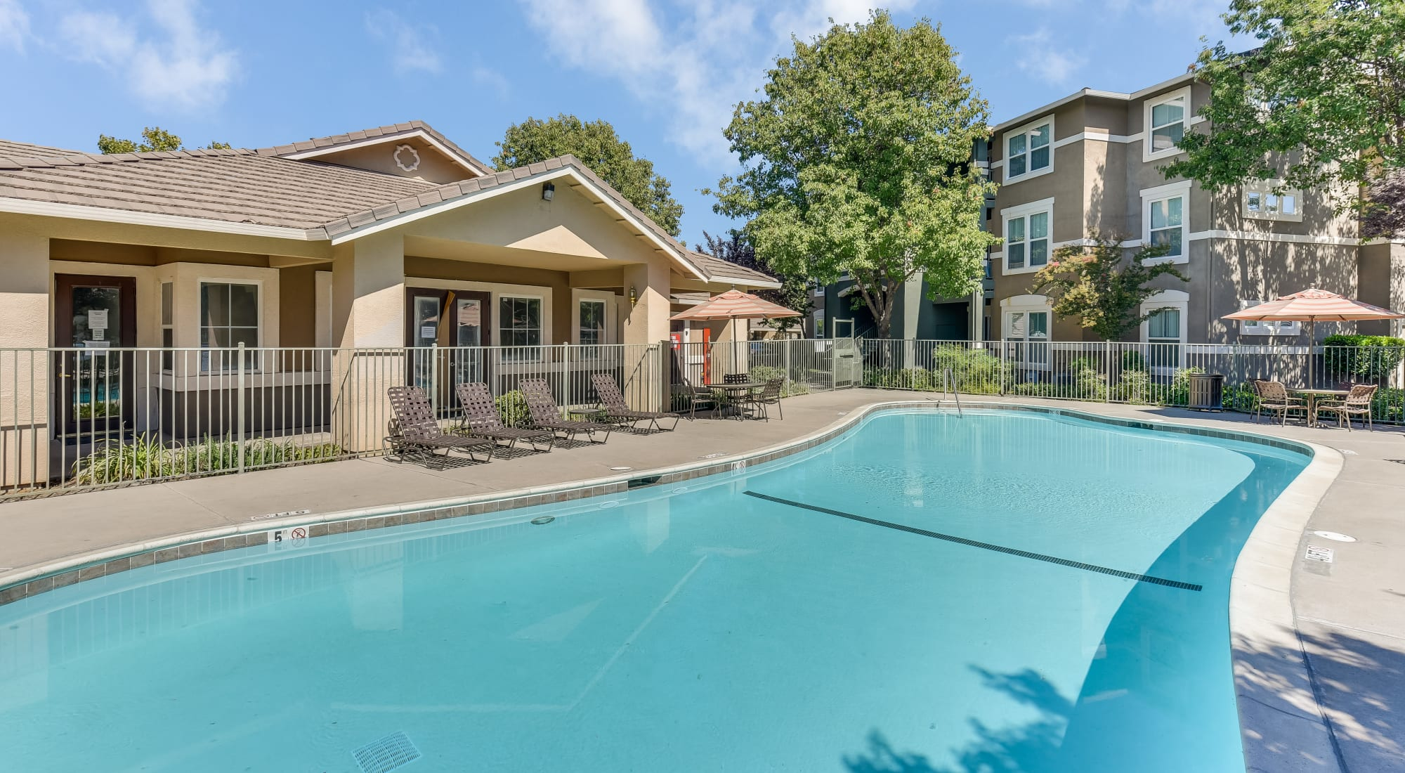 Natomas Park Apartments features a relaxing pool and hot tub, in Sacramento, California