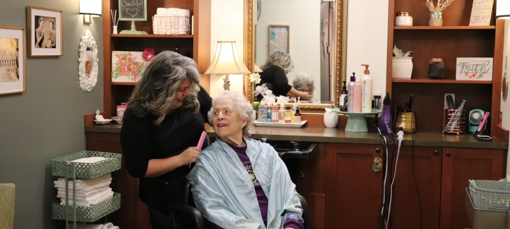 Resident getting her hair done at The Springs at Carman Oaks in Lake Oswego, Oregon