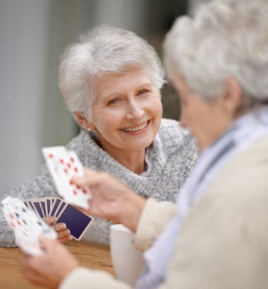 Seniors playing cards at Las Soleras Senior Living in Santa Fe, New Mexico