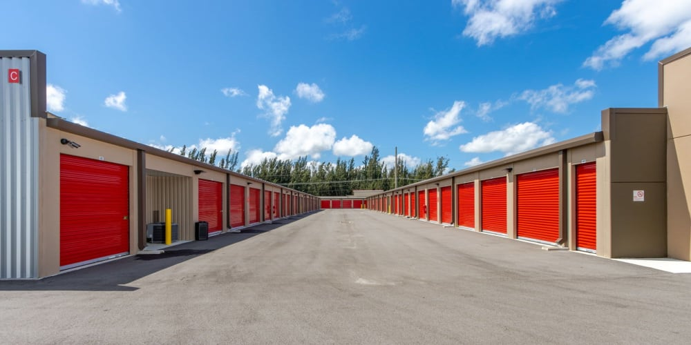 Outdoor units withbright doors at StorQuest Express Self Service Storage in Cape Coral, Florida