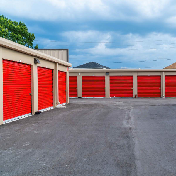 Outdoor storage units with red doors at StorQuest Express - Self Service Storage in Sonora, California