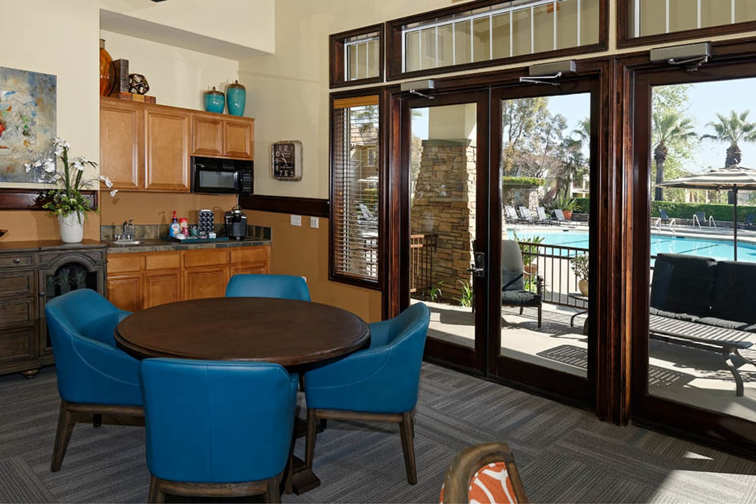 Clubhouse tables and kitchenette at Camino Real in Rancho Cucamonga, California