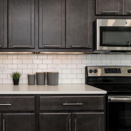Modern kitchen appliances at Alexander Pointe Apartments in Maineville, Ohio