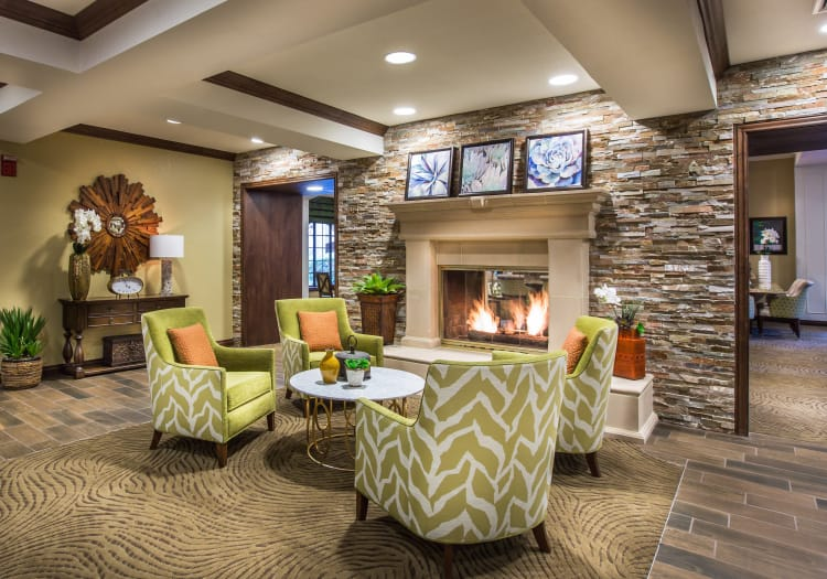 Common area with a fireplace at The Country Club of La Cholla in Tucson, Arizona