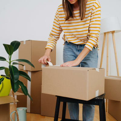 A woman packing boxes to store at Storage Star Folsom in Folsom, California