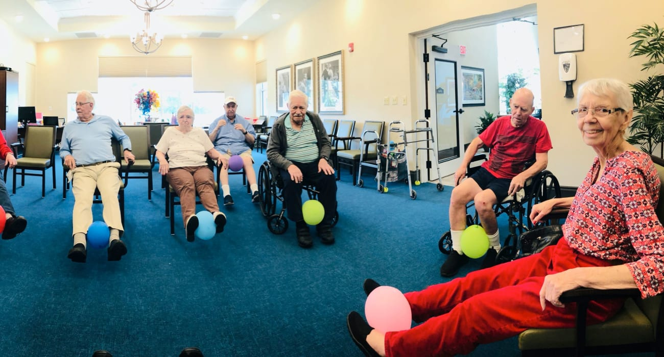 Residents playing a game at CERTUS Premier Memory Care Living in Orlando, Florida.