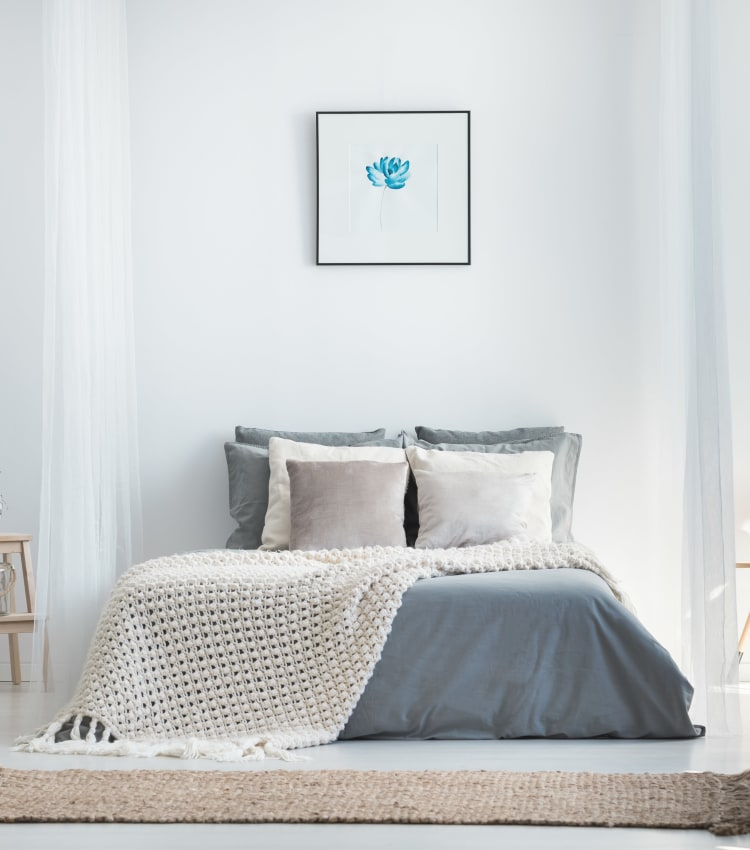 Minimalist decor in a model home's bedroom at Sofi at Morristown Station in Morristown, New Jersey