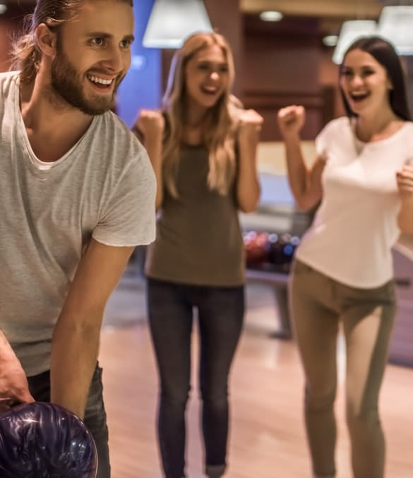 Group of friends from Vieux Carre Apartments going bowling nearby
