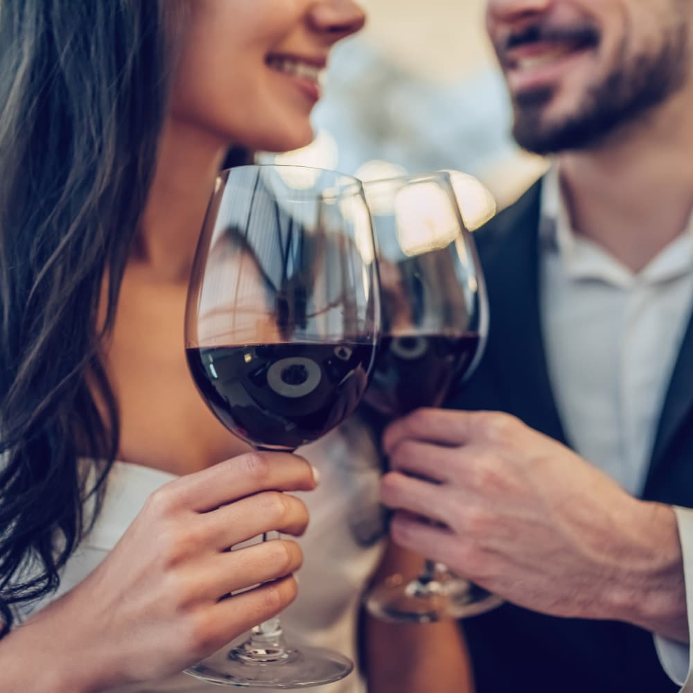 A couple enjoying red wine together at a restaurant in Camden, New Jersey