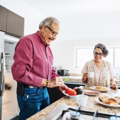 Older couple preparing breakfast in bright kitchen at Alante at the Islands in Chandler, Arizona