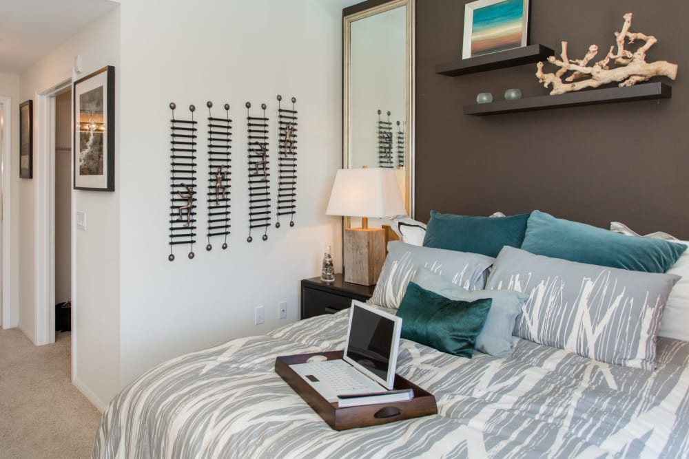 Well-furnished master bedroom in a model home at Paragon at Old Town in Monrovia, California