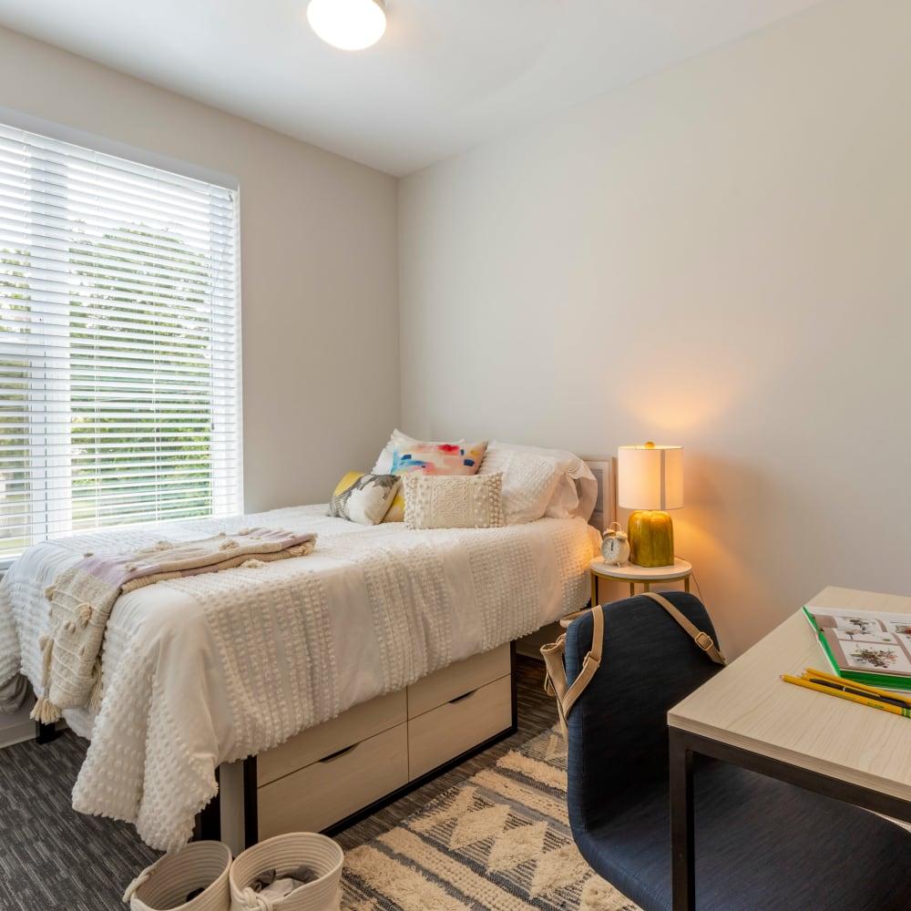 Cozy bedroom at UNCOMMON Wilmington in Wilmington, North Carolina
