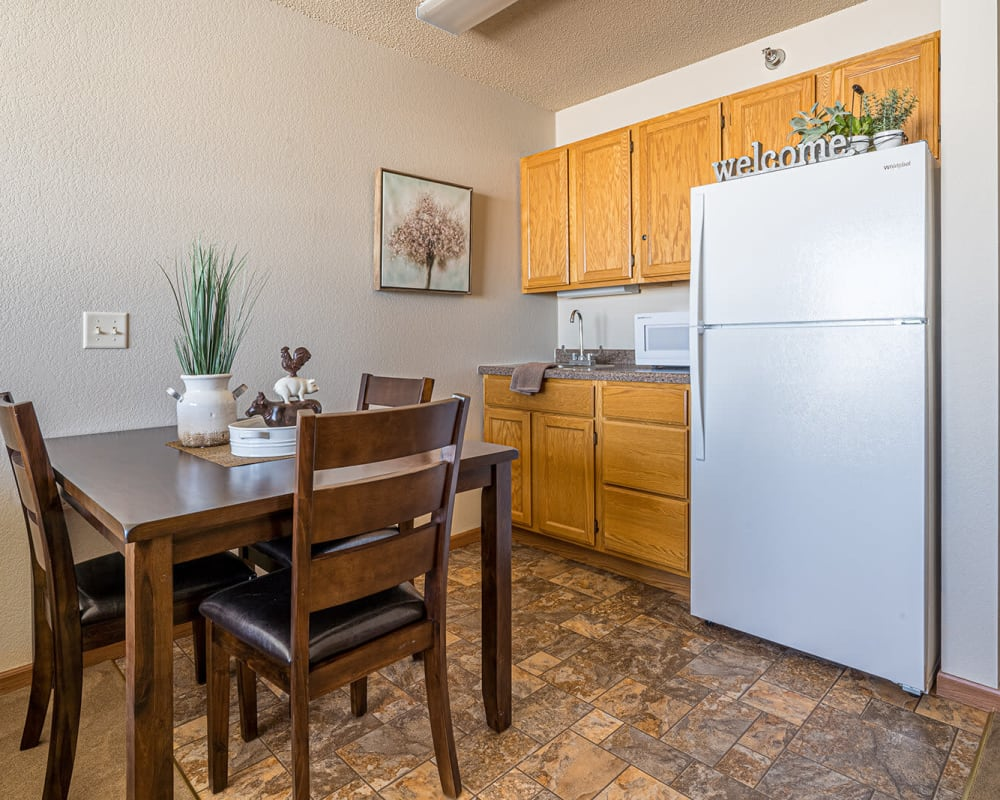 Resident apartment with a kitchenette at Traditions of Owatonna in Owatonna, Minnesota.