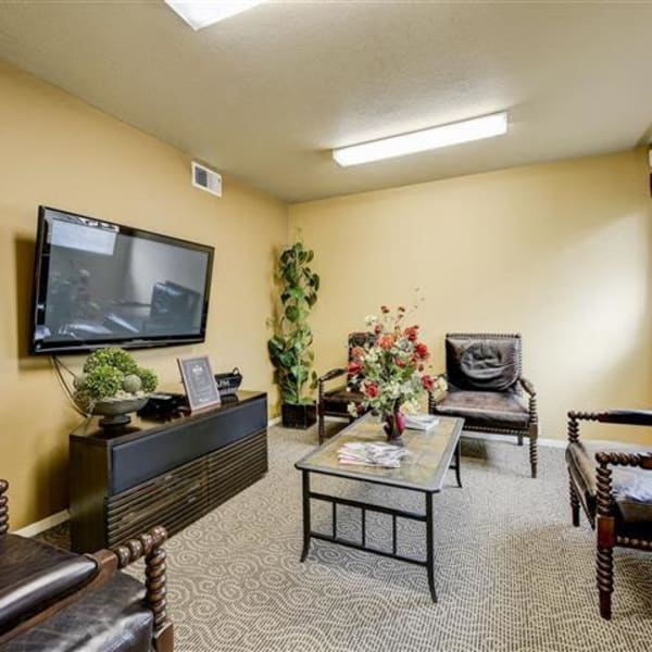 Resident lounge with a flat-screen TV at Northwind Apartments in Reno, Nevada