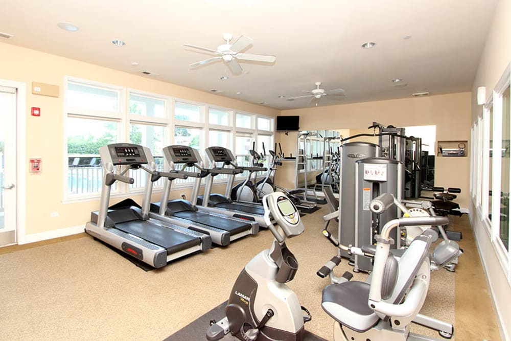 Fitness center with plenty of individual workout stations at Riverstone Apartments in Bolingbrook, Illinois