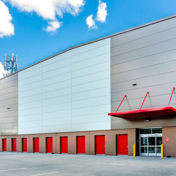 Outdoor storage units with bright doors at StorQuest Self Storage in Gainesville, Florida