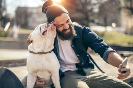 Man taking a selfie with his dog near Berkshire Laurel Creek, Fairfield, California
