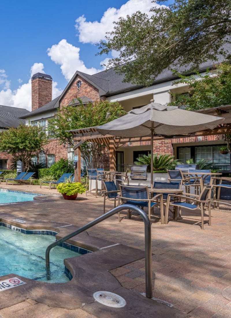 Pool and covered seating at Marquis on Memorial in Houston, Texas