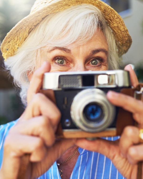 A woman taking a photo at Trilogy Health Services in Louisville, Kentucky