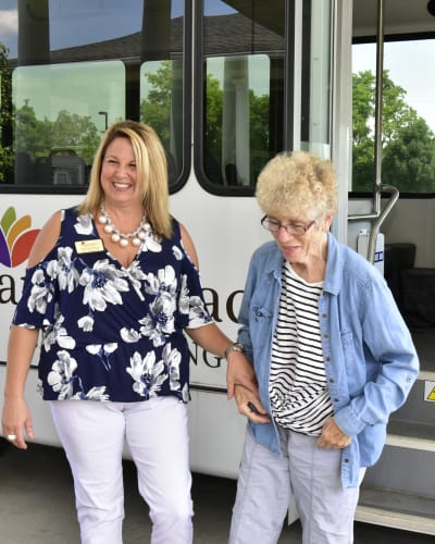Resident and staff member coming off the activity bus at Garden Place Columbia in Columbia, Illinois.