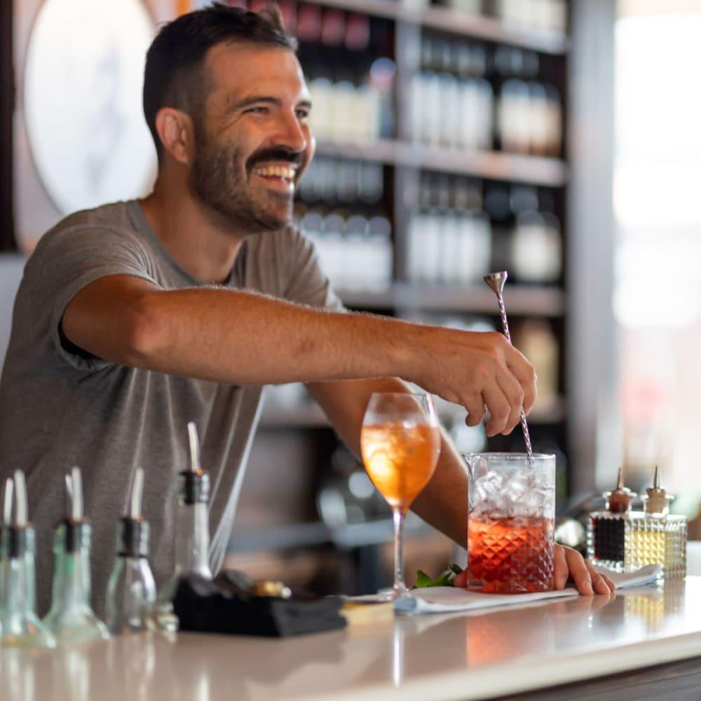 Bartender mixing up a delicious cocktail at a restaurant near Oaks Braemar in Edina, Minnesota