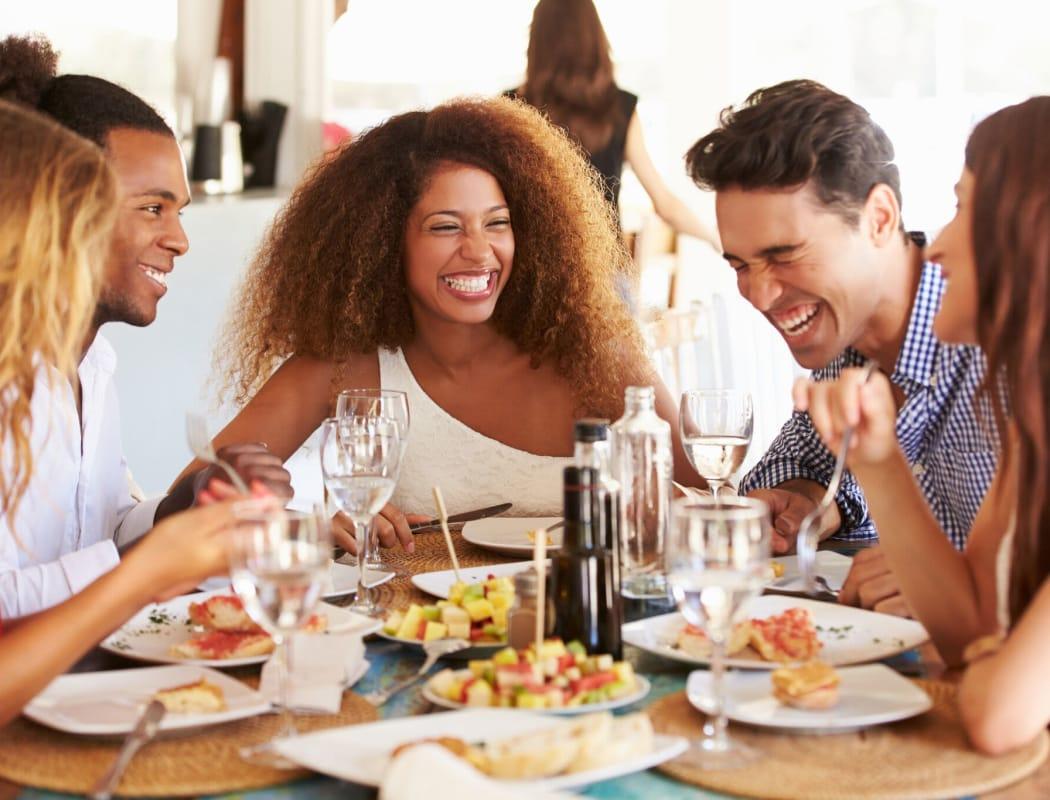 Friends eating near Verandahs of Brighton Bay