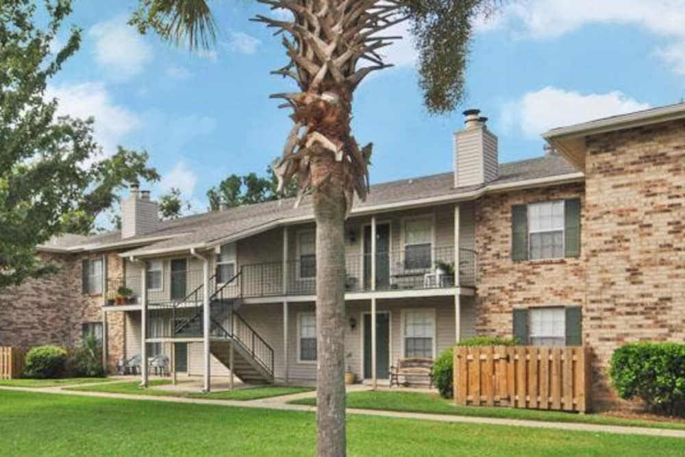 Apartments and lawn view at French Colony Apartments in Lafayette, Louisiana
