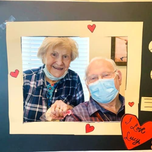 Resident couple posing in a picture frame at The Oxford Grand Assisted Living & Memory Care in McKinney, Texas
