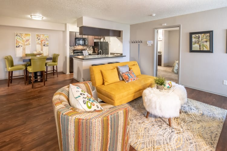 Open concept floor plan with hardwood floors and modern decor at Trails of Towne Lake in Irving, Texas