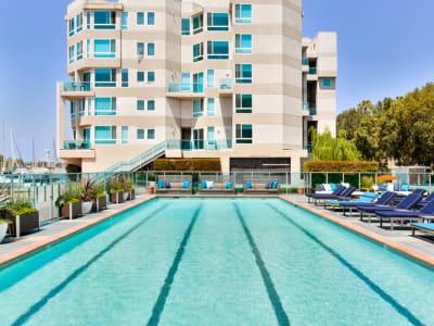 Resort-style swimming pool with underwater lap lanes at Esprit Marina del Rey in Marina del Rey, California