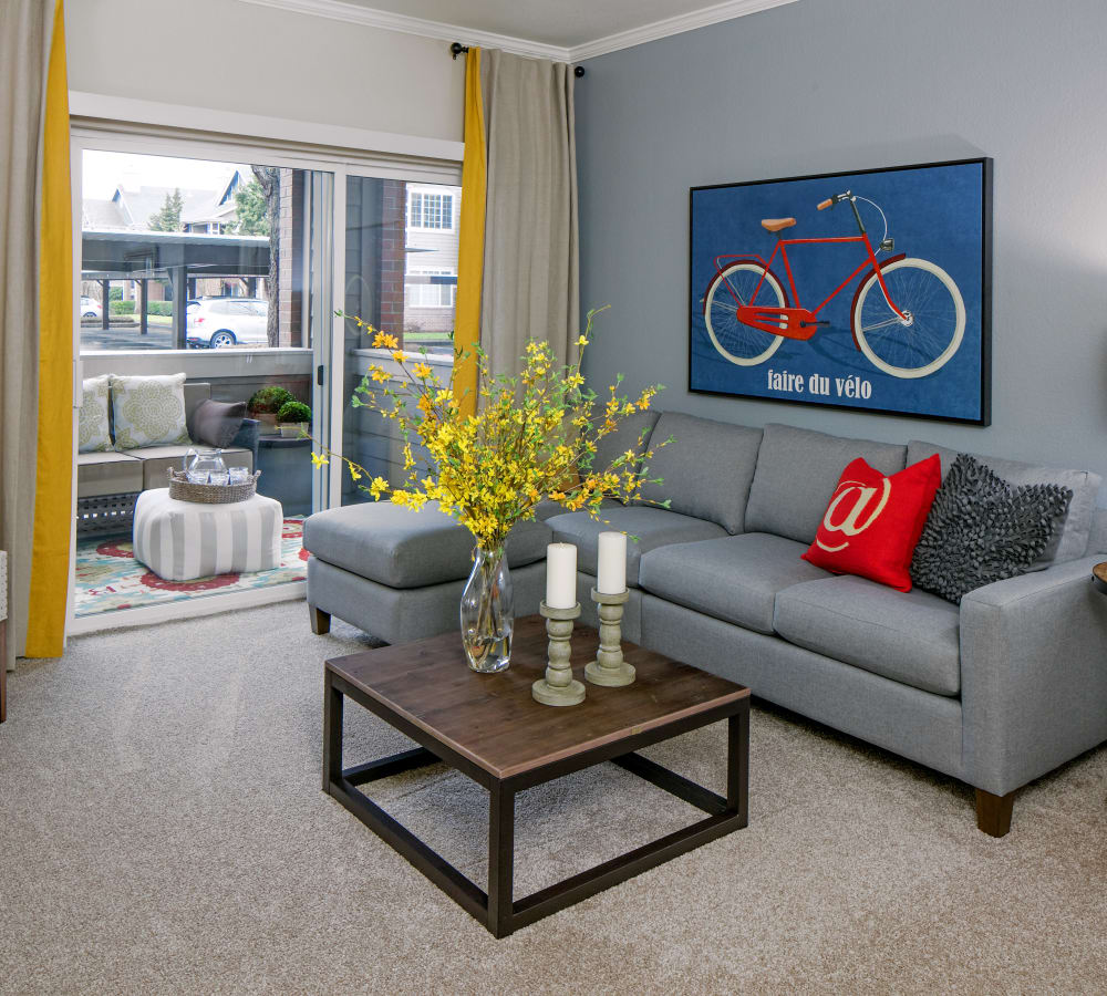Living room with patio access at Cortland Village Apartment Homes in Hillsboro, Oregon