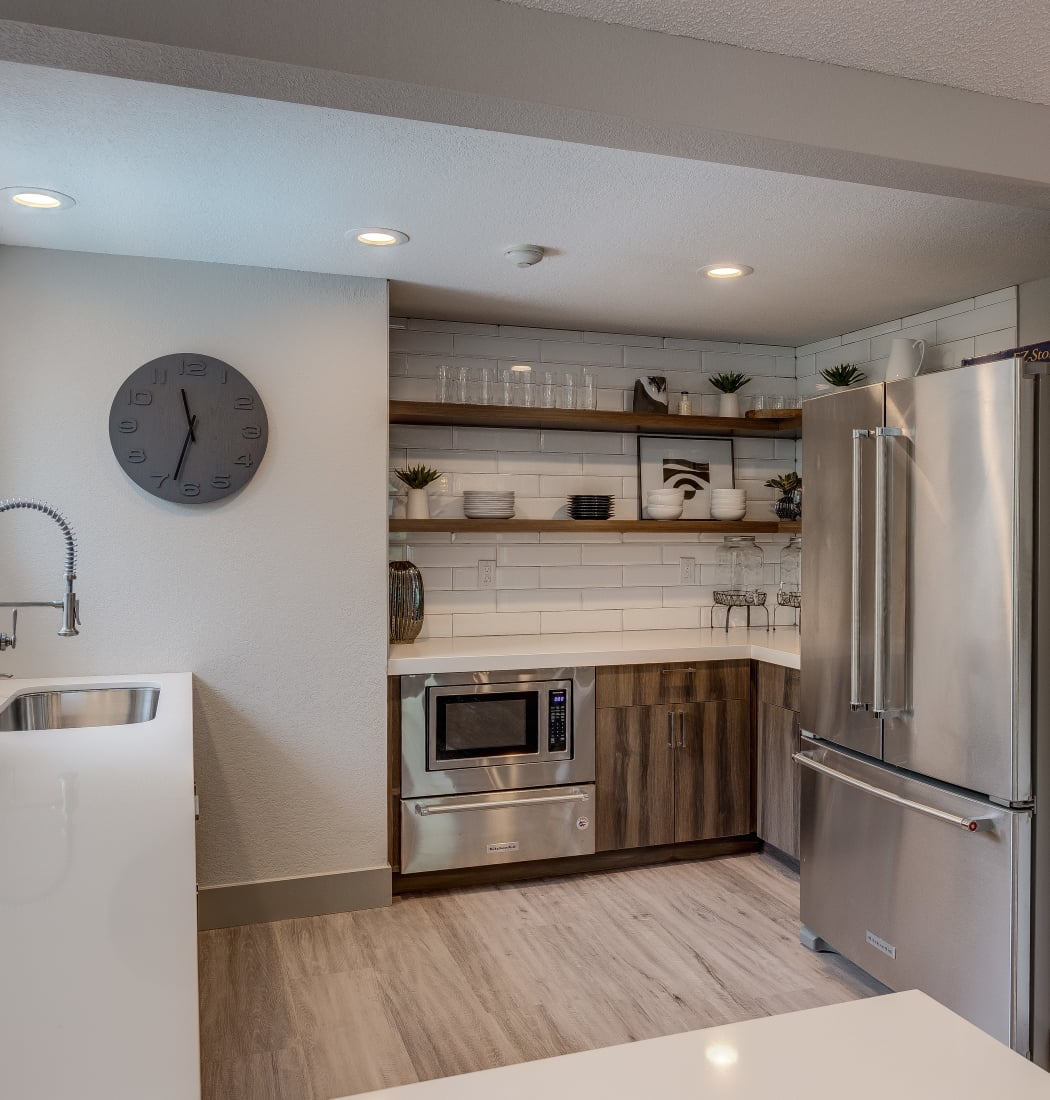 Lovely modern kitchen with stainless-steel appliances at Alaire Apartments in Renton, Washington