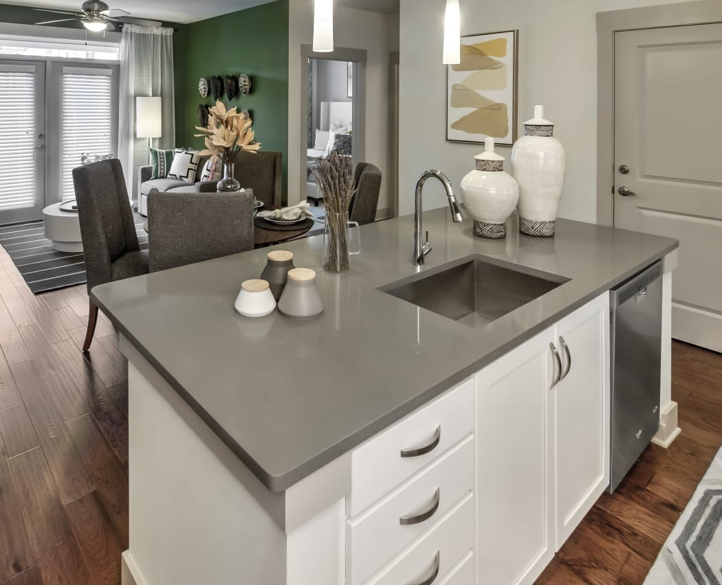 Kitchen island and modern living room at Juncture in Alpharetta