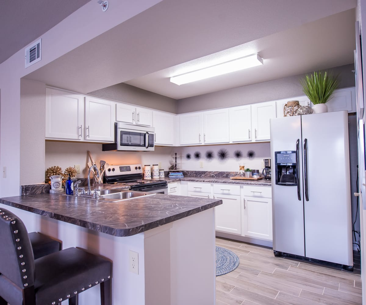 Kitchen with stainless steel appliances at Scissortail Crossing Apartments in Broken Arrow, Oklahoma