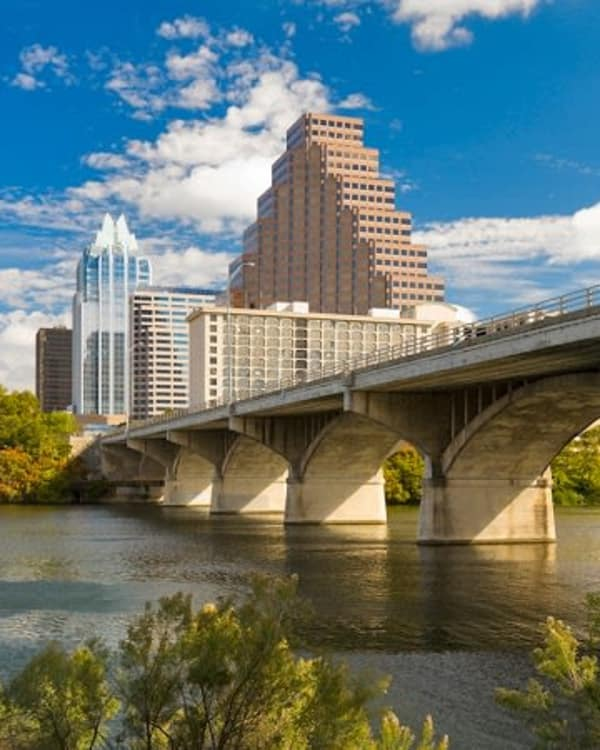 Historic bridge and highrise buildings near Link in Austin, Texas