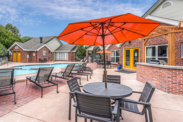 Dining place near to the swimming pool at Keystone Apartments in Northglenn, Colorado